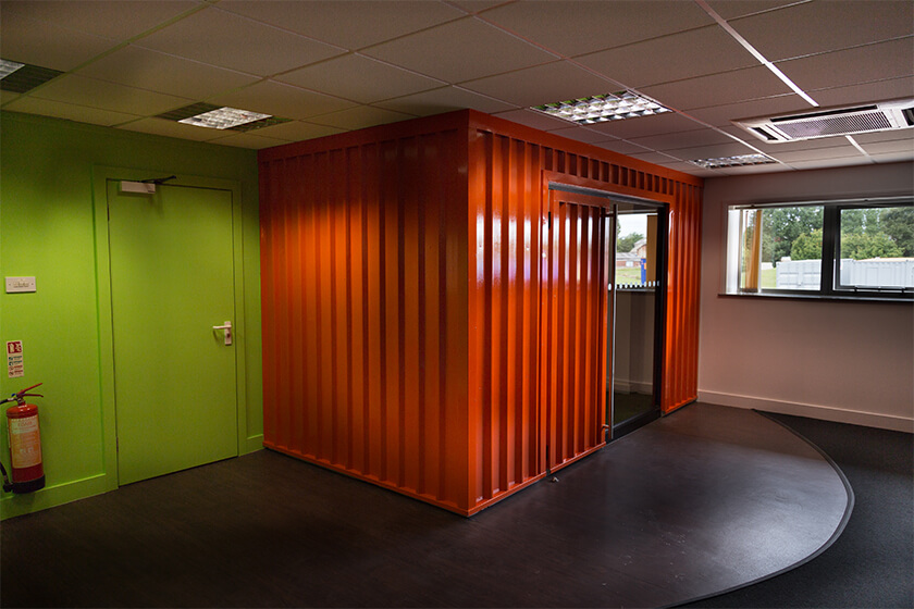 A meeting room with a difference: bright orange container