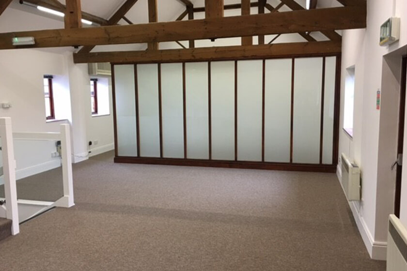 The old screen and flooring in Mocha Marketing's office in need of replacing